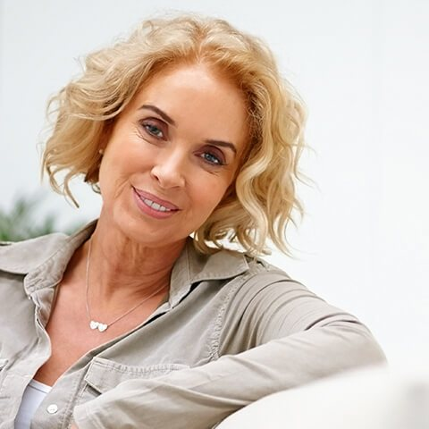 Woman with a beautiful smile, thanks to cosmetic dentistry from our dentist in Lititz, PA