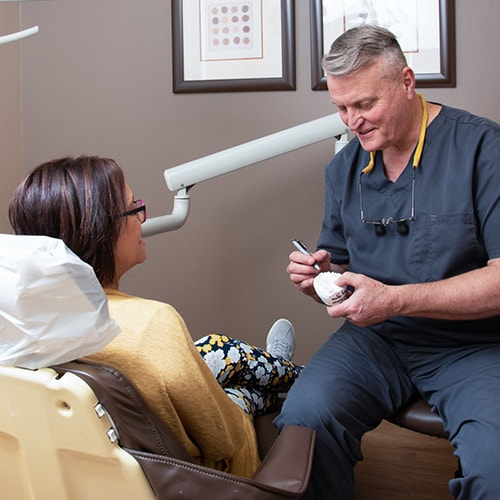 Dr. Berg talking to a patient about his Lititz dental services