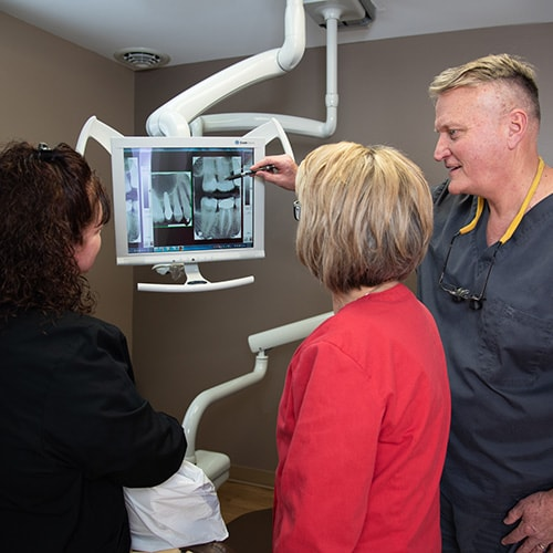 Dr. Richard Berg talking about dental implants with a Lititiz, PA patient